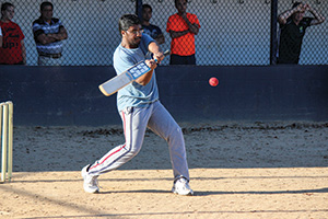 An FSU student from India hits the ball during a cricket match hosted by the Indian and South Asian Student Association.