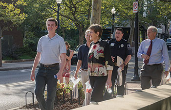 Campus police, faculty, staff, students, and community members participate in the annual LION Walk at Penn State.