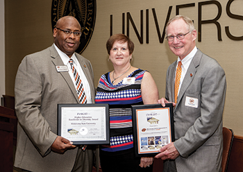 Chief Diversity Officer Jason F. Kirksey (left) and OSU President V. Burns Hargis accept OSU's fifth Higher Education Excellence in Diversity (HEED) Award from INSIGHT Into Diversity Publisher Lenore Pearlstein in September (photo courtesy of Gary Lawson/Oklahoma State University Marketing).