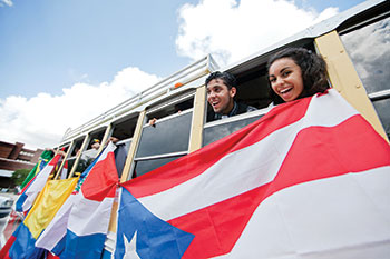UCF students promote their heritage by displaying a Puerto Rican flag.