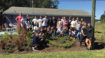 IES students work in the UCF community garden, a collaborative effort between the student body and the UCF Arboretum.