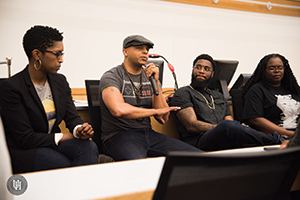 Artists and community leaders discuss issues affecting marginalized identities at the Poetic Justice event.