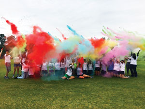 UNF students participate in the Interfaith Center's Color Run to celebrate the Hindu festival of Holi.
