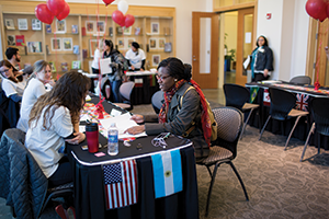 IU Bloomington staff help students register for free passports at the on-campus Passport Caravan event.