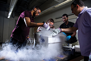 Associate professor of physics Paul Quinn (right) leads a group of students during a summer research project as part of the KU BEARS program.