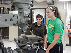 Students at the WE@RIT Open House test their skills using some of the manufacturing equipment in RIT's engineering labs.