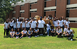 High school GEE participants pose in front of the University of Memphis tiger