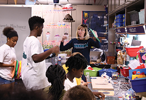 students make rice bags in the Makerspace at the University of North Carolina Wilmington as part of a Junior Seahawk Academy community service project