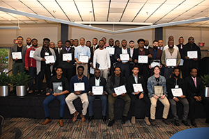 Brother 2 Brother chapter members accept certificates at an event at Old Dominion University. (Photo by Aaron Hodnett)