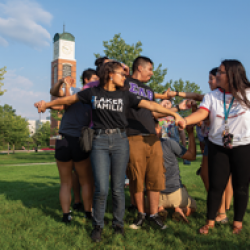 Latinx students at GVSU participate in a team-building activity during new student orientation as part of a year-round student success program called Laker Familia.