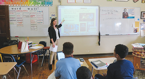 Capt. Laura Cortese of the U.S. Army instructs students as a teacher resident at AMY Northwest Middle School in Philadelphia.