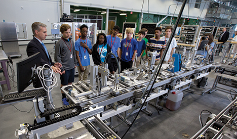 Area middle school students learn about manufacturing at CMI as part of the GE Bridge to Learning initiative at GTC.