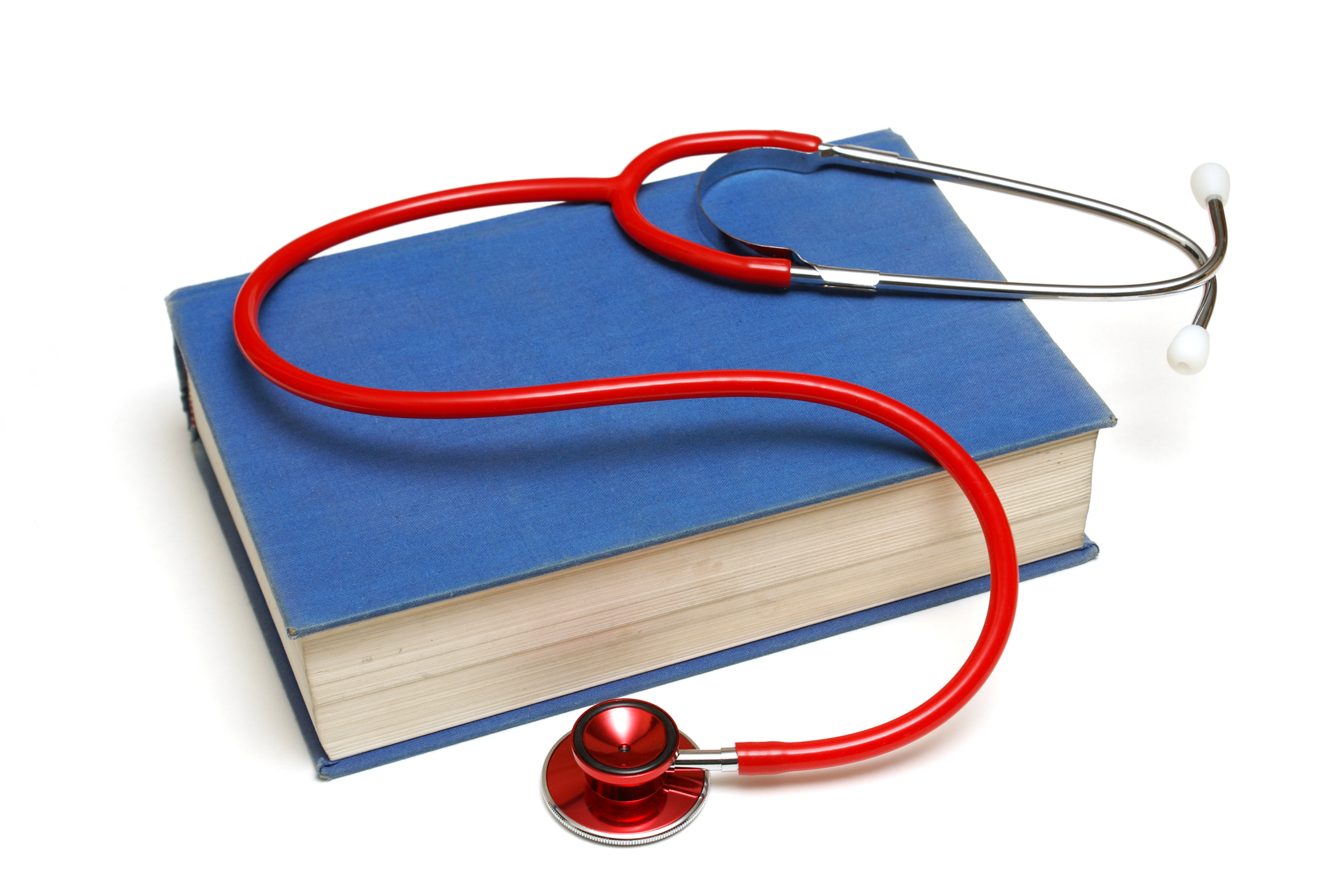 Photo of a stethoscope lying on top of a textbook.