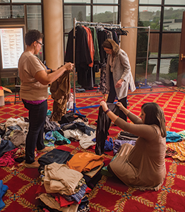 CSW members volunteer for the commission's Suits for Success clothing drive, which collects two to three tons of clothing for women in need each year.