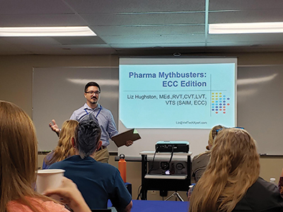 Dru Mellon introduces a presenter at the Utah Society of Veterinary Technicians and Assistants' first continuing education conference in July 2019.