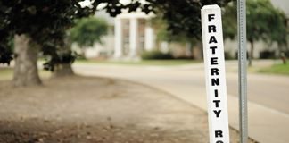 Photo of a sign on a college campus that reads Fraternity Row