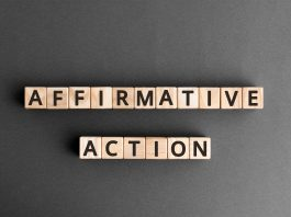 """Photo of wooden letter tiles arranged to spell out """"affirmative action."""""""