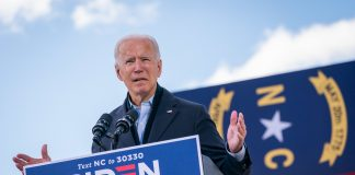 Photo of President-elect Joe Biden standing at a podium at a campaign rally