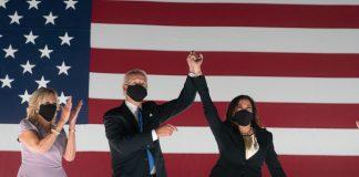President Joe Biden, Vice President Kamala Harris, and First Lady Jill Biden celebrate their presidential win in front of an American flag.