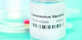 Photo of a vial that contains a label reading Coronavirus Vaccine