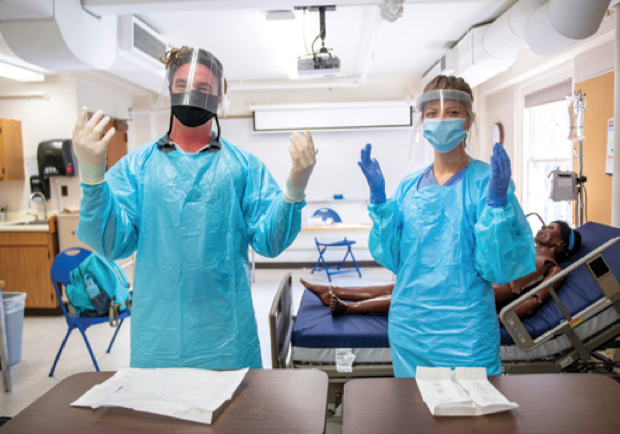 A photo of University of Maine School of Nursing students wearing full personal protective equipment to conduct simulation labs.