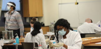 Photo of at pharmacy students at the Medical College of Wisconsin working in a laboratory that has been rearranged to allow for social distancing