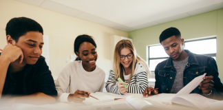 Photo of a group of students, three Black and one White, studying together.