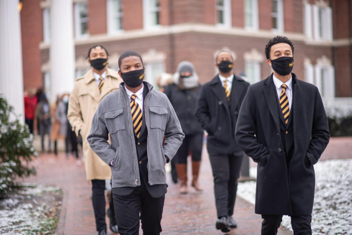 Photo of students and faculty at Ohio University walking on campus during Martin Luther King Jr. Day celebrations.