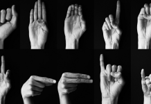 Black and white photos of hands making the signs of the American Sign Language alphabet