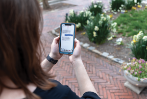 A student reads a message sent by Climatext on their smartphon