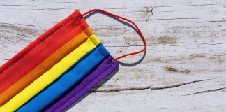 Photo of a face mask in LGBTQ Pride colors.