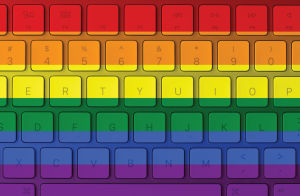 Photo of a computer keyboard that is in LGBTQ Pride colors.