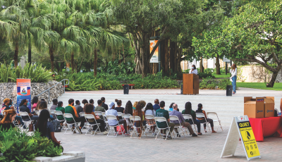 (Left) On August 26, dozens of University of Miami students, faculty, and staff gathered for a vigil to commemorate the lives impacted by the recent earthquake in Haiti. Photo courtesy of University of Miami.