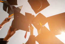 A group of mortar boards are being  thrown up to the sky, October 3, 2021